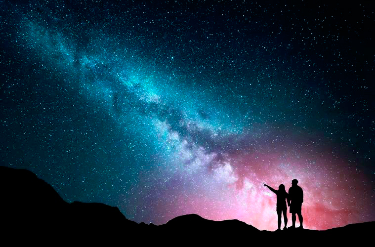Couple-Pointing-at-Galaxy